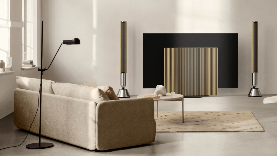 Bang & Olufsen Beolab 28 speakers aside a Beovision Harmony OLED TV in a designer living room