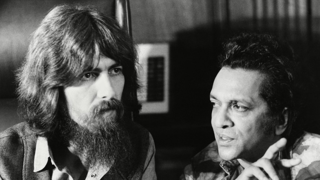 Beatle George Harrison and Ravi Shankar in conversation in 1971