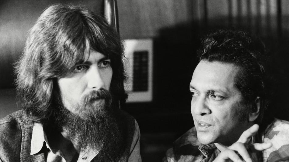 Beatle George Harrison and Ravi Shankar in conversation in 1971