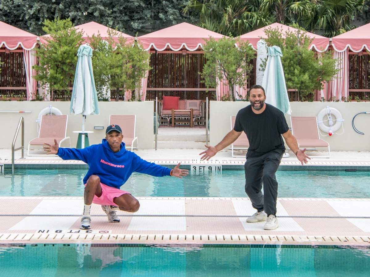 Pharrell Williams and David Grutman pose by the pool at the Goodtime Hotel
