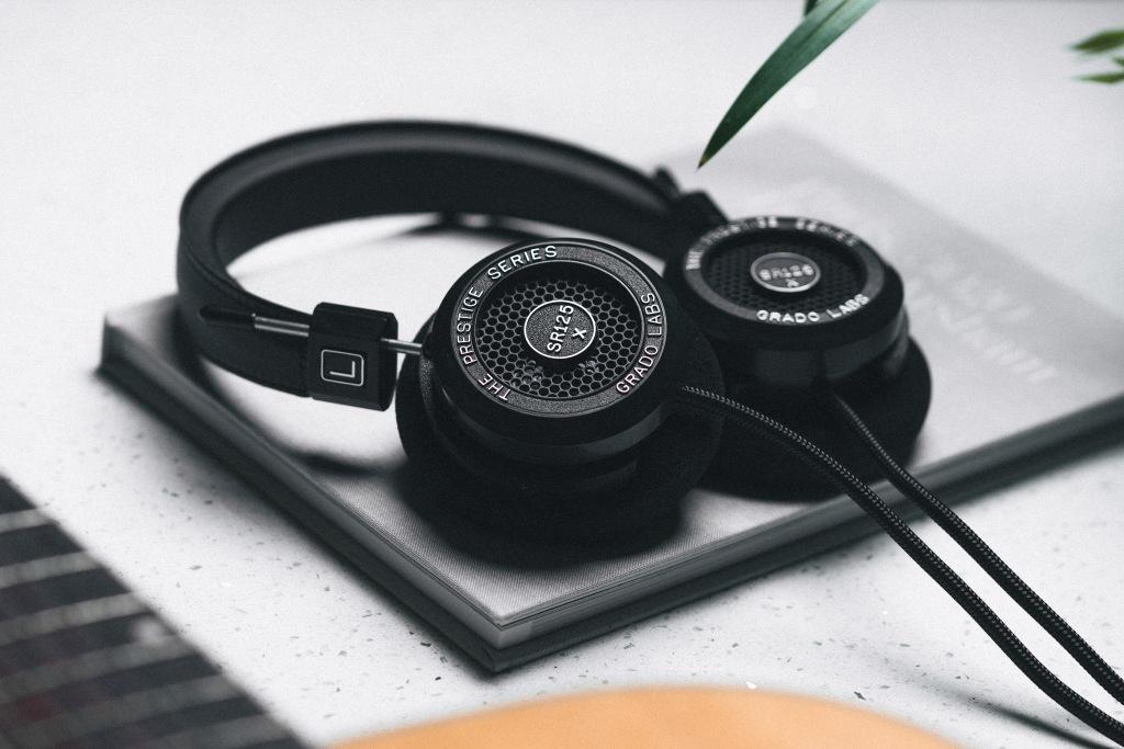 The Grado SR125x headphones on a notebook