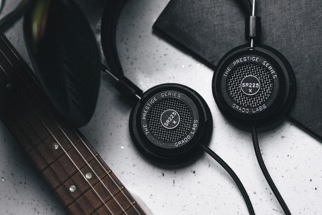 The Grado SR225x headphones alongside a guitar