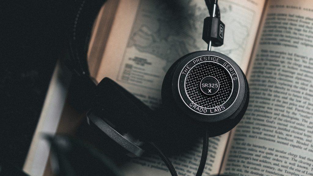 Grado Labs SR325 Prestige X Series headphones resting on a book