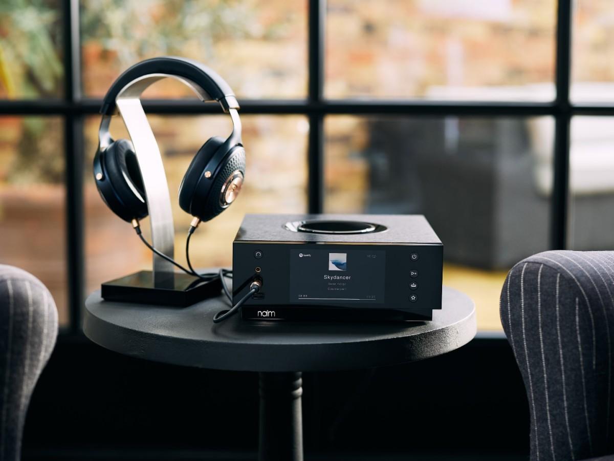 Uniti Atom Headphone Edition Hi-Fi with headphones in a living room setting