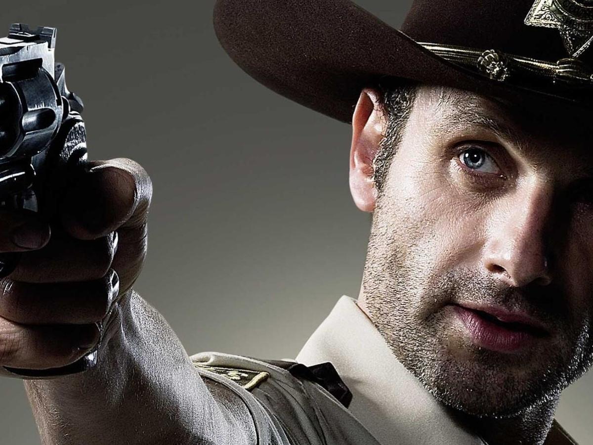 Andrew Lincoln as Rick Grimes in The Walking Dead wielding a pistol