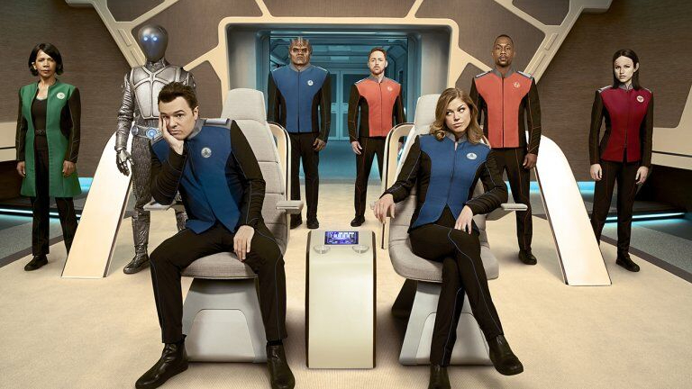 The crew of the Orville pose on the starship bridge