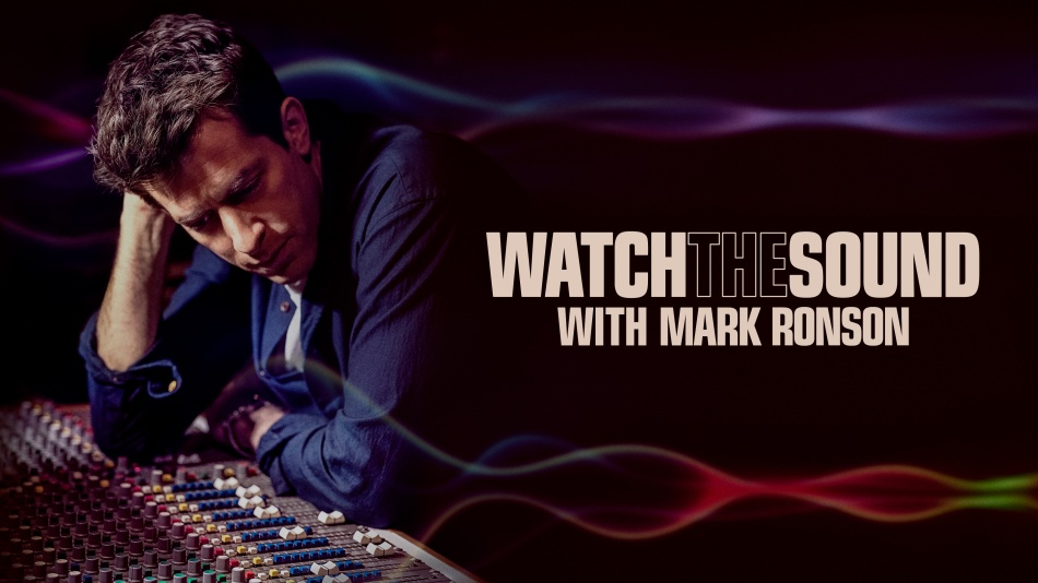 Mark Ronson stares at a mixing desk in a recording studio
