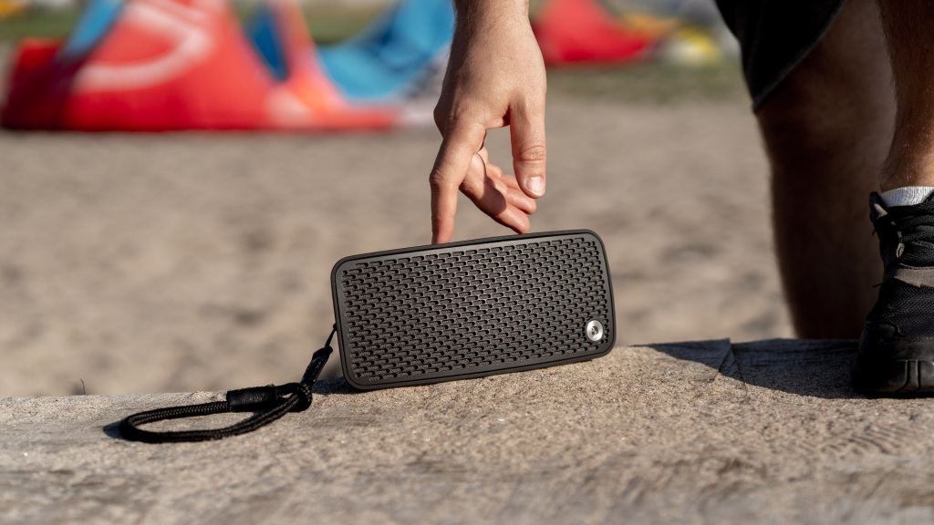 Audio Pro P5 wireless speaker on a beach front