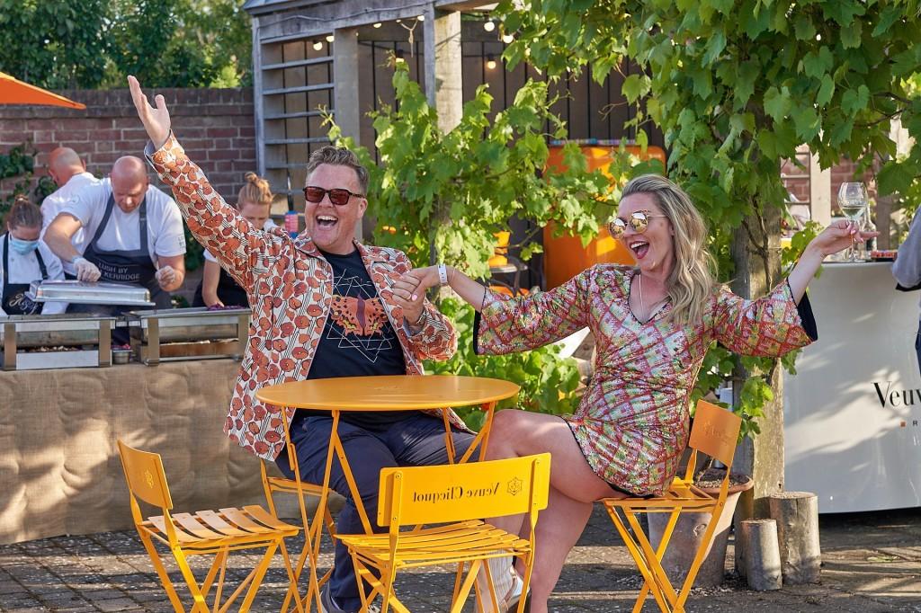 Couple wine and dine al fresco at luxury hotel