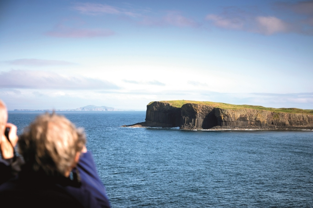 Holiday makers pass by Fingal's Cave on a Fred Olsen cruise ship