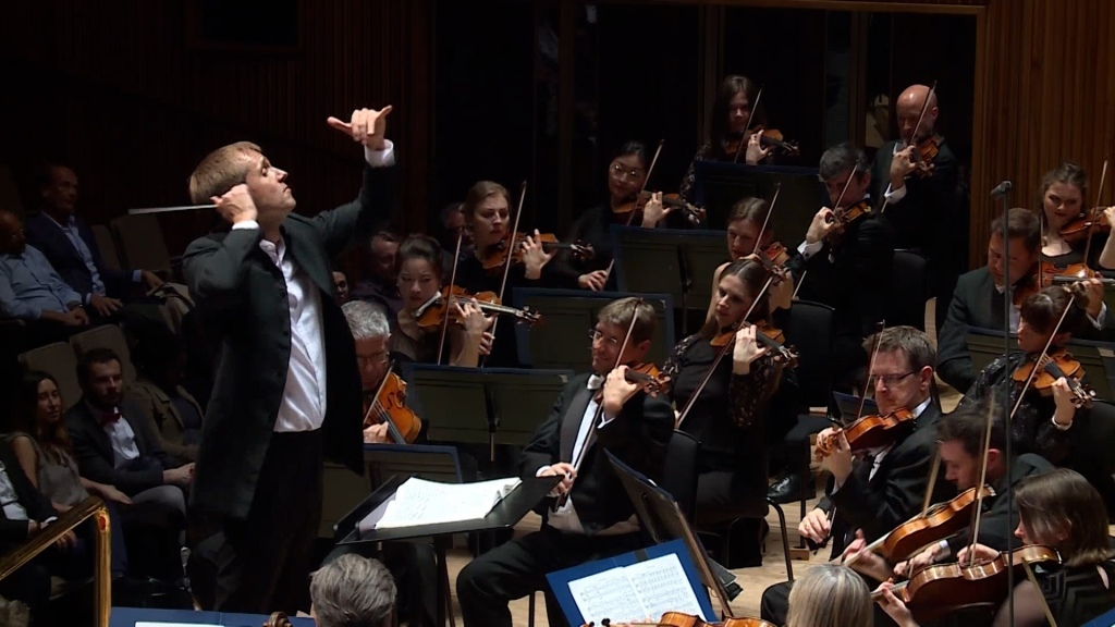 Royal Philharmonic Orchestra being conducted in a live performance