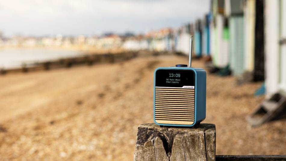 Ruark Audio R1 Mk4 digital radio on the beach in front of beach huts