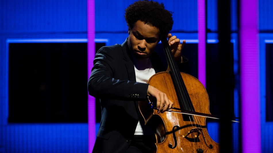 Musician Sheku Kanneh-Mason playing his cello