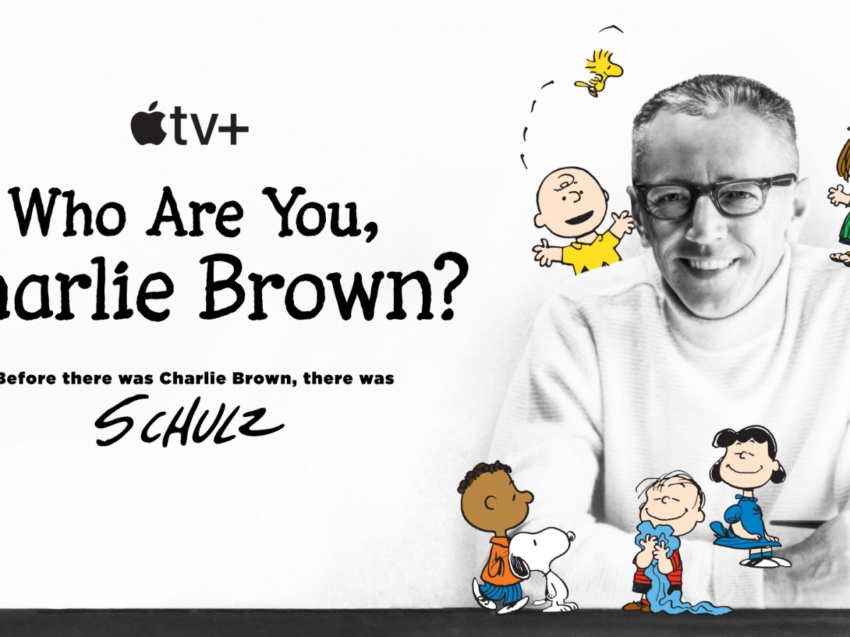 Peanuts creator Charles M. Shultz surrounded by his characters, including Charlie Brown and Snoopy