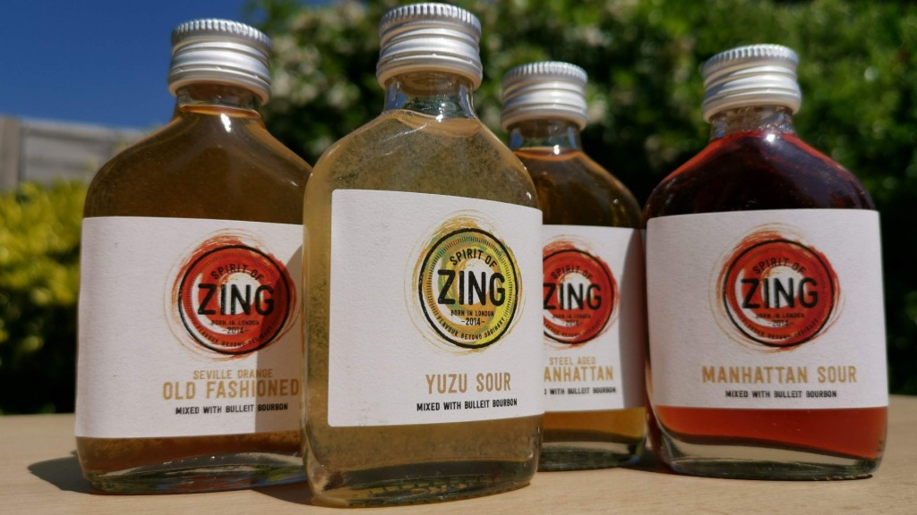 A set of four whiskey cocktails in 50ml bottles in the sun