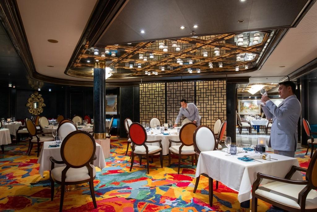 Waiters prepare glasses in Fred Olsen Borealis Colours & Tastes restaurant