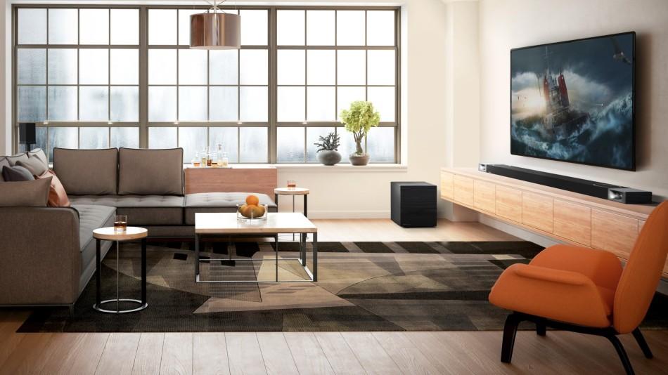 A Klipsch Cinema 1200 soundbar under a TV in a minimalistic living room