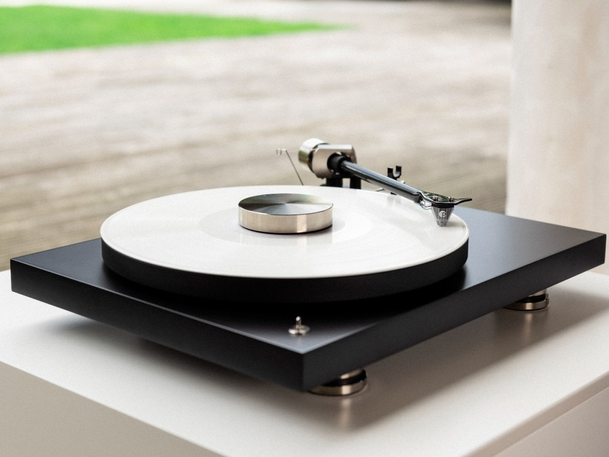 Pro-Ject Debut Pro turntable looks out onto a garden