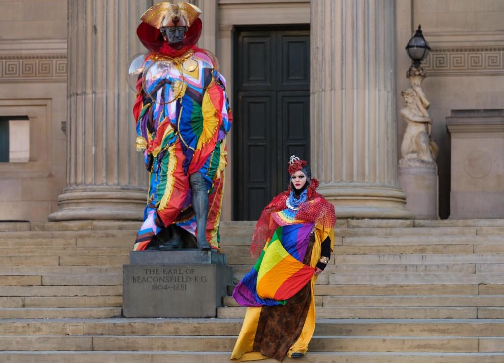 Statue of Benjamin Disraeli dressed in bright rainbow colours