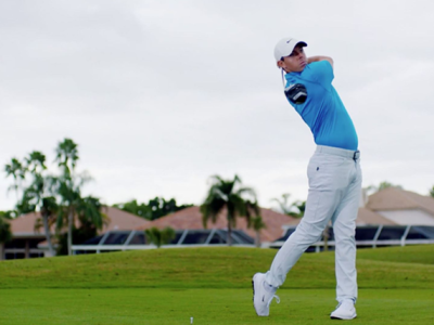 Golf superstar Rory McIlroy takes a swing on the green