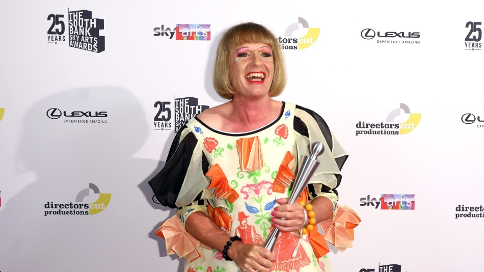 Grayson Perry holds award at South Bank Show Awards 2021