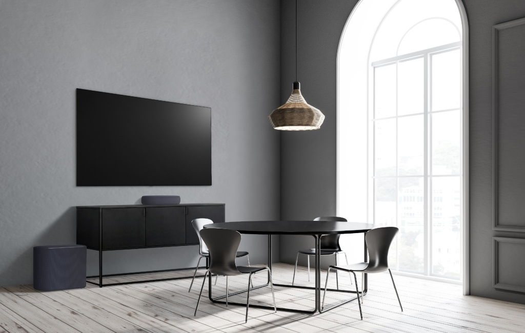 The black version of the LG Éclair soundbar in a black-clad living room