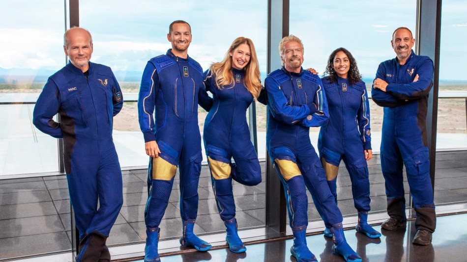 The Virgin GalacticUnity22 Crew with Richard Branson in their blue space suits