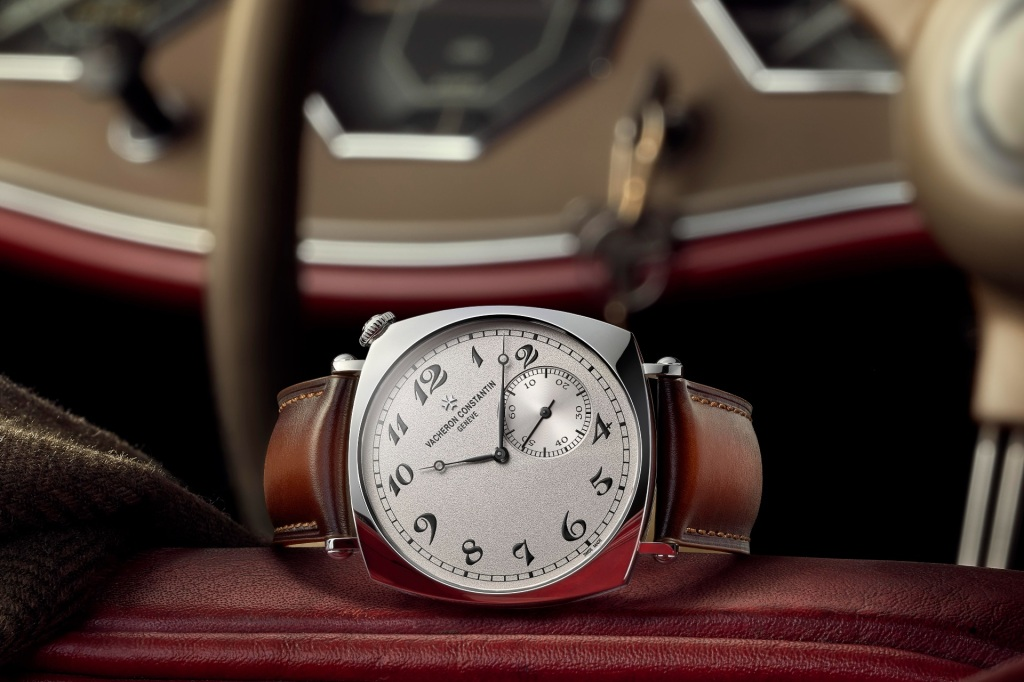 A luxury watch on the driving seat of a classic car