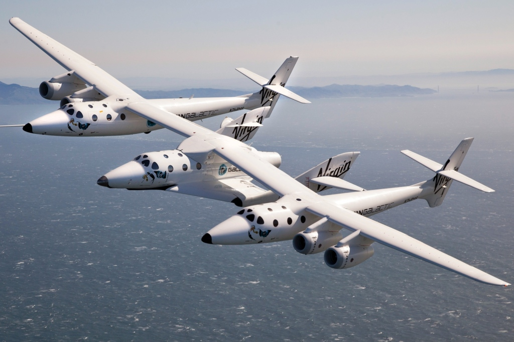 Virgin Galactic VMS Eve and SpaceShipTwo fly over the San Francisco Bay