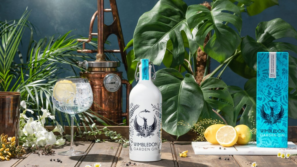 A Wimbledon Garden gin bottle surrounded by lemons and a G&T serve