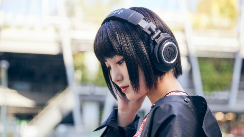 Audio Technica ATH-M50xBT2 headphones worn by an Asian lady out and about