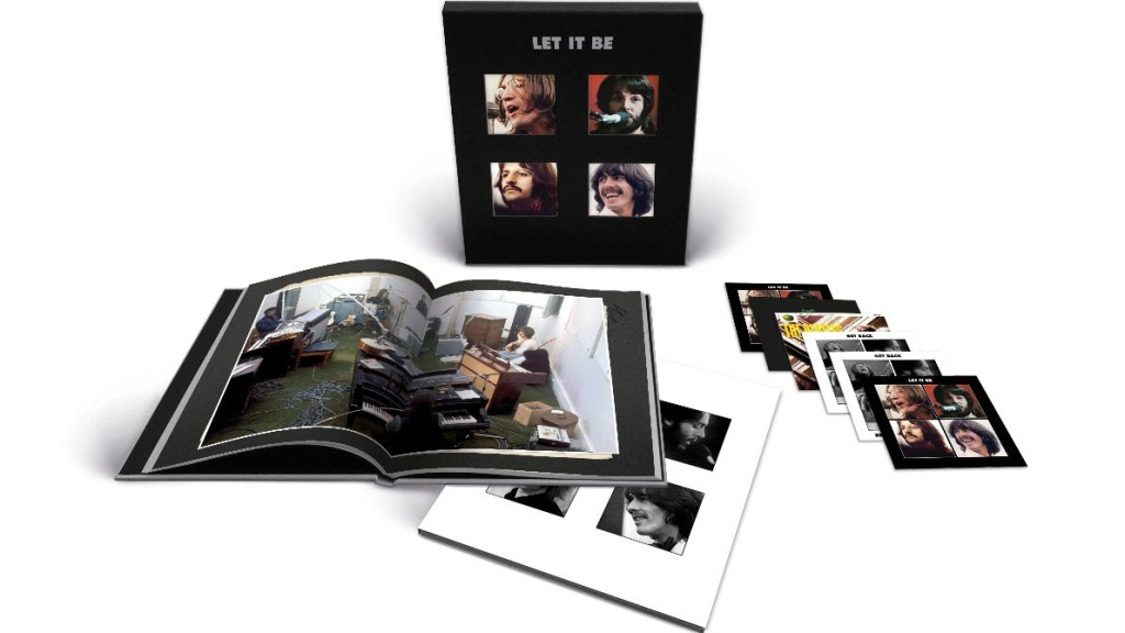 The Beatles Let it Be Super Deluxe collection pack opened up to show book and discs