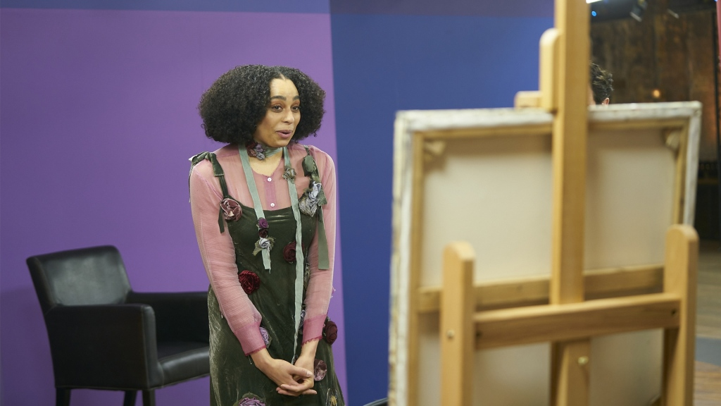A celebrity reacts at her portrait in Portrait Artist of the Year season 8
