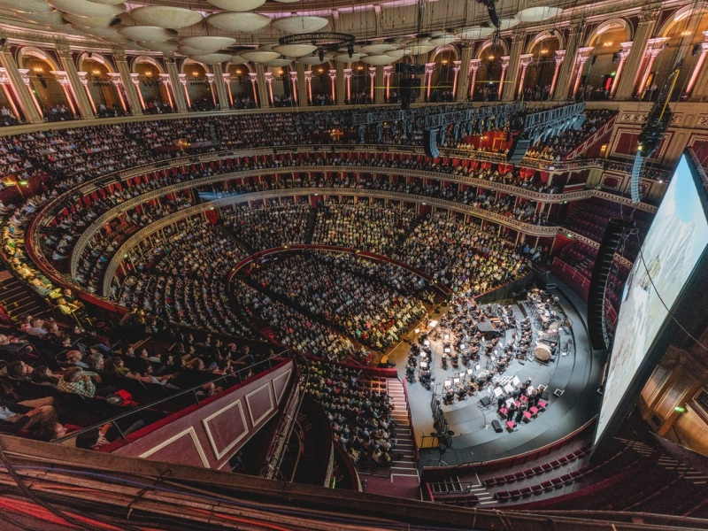 A stunning view of the Royal Albert Hall auditorium with ginat cinema screen