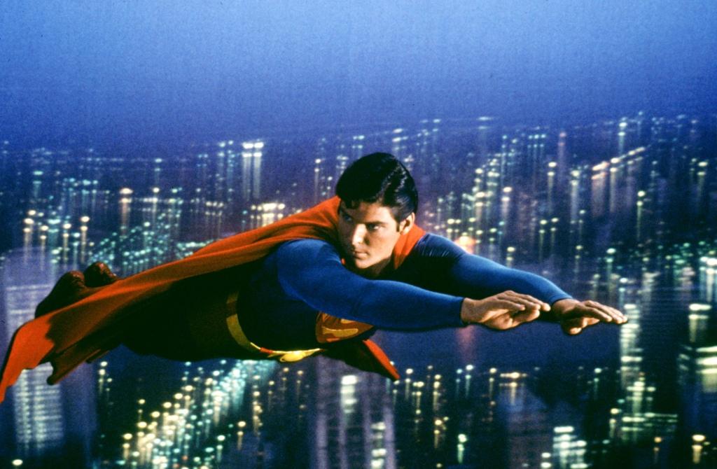 Christopher Reeve as Superman flies above Metropolis