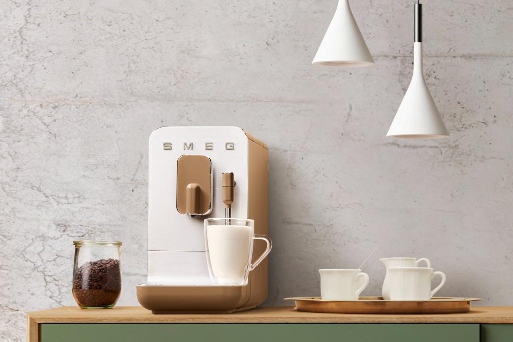 The Smeg BCC02 coffee machine making frothy milk