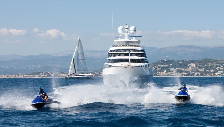 Superyacht Azzurra II flanked by jetskies