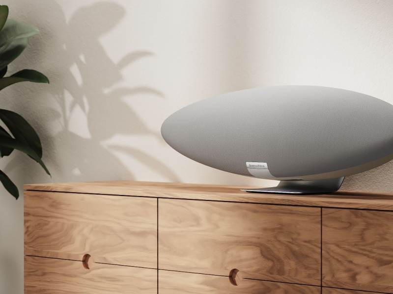 The Pearl Grey Bowers & Wilkins Zeppelin wireless speaker on a wooden sideboard