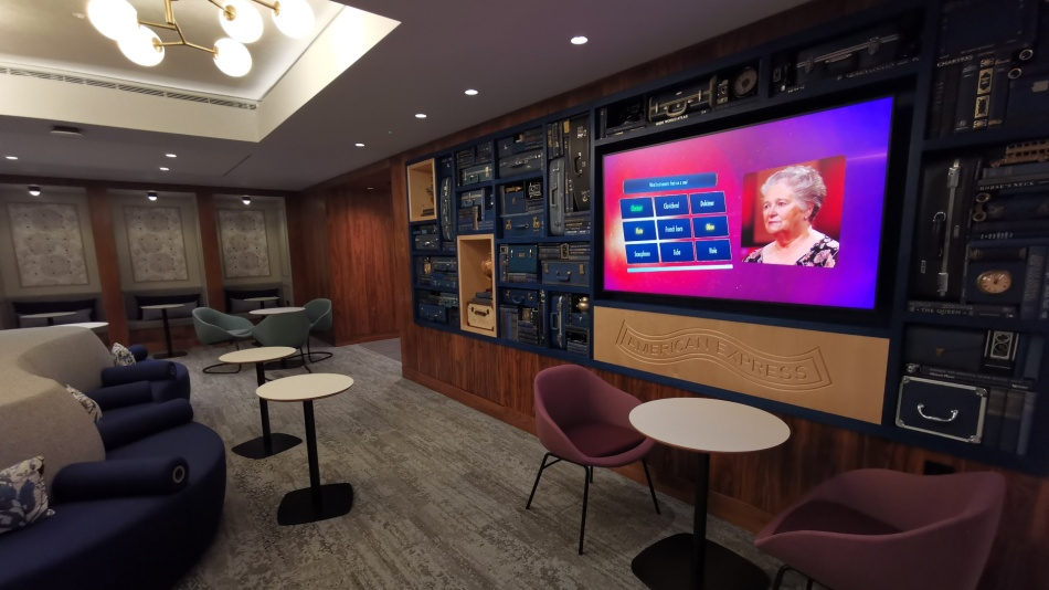 The Ammex Centurion lounge area at LHR with large TV display