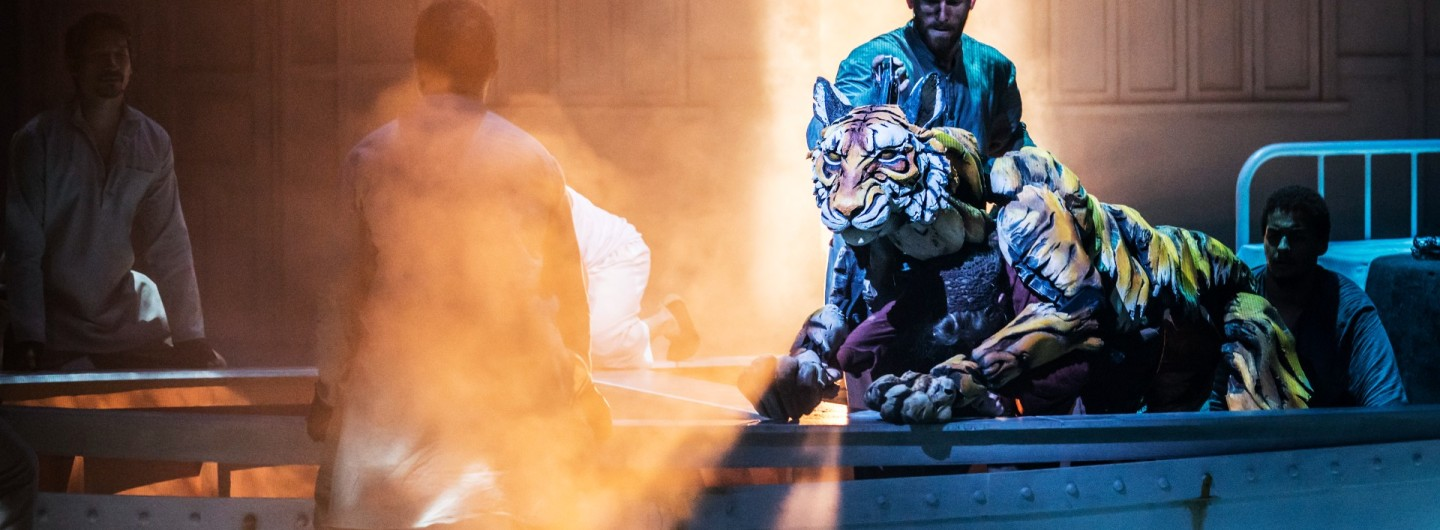 Owain Gwynn and Richard Parker performing as the Tiger in Life of Pi